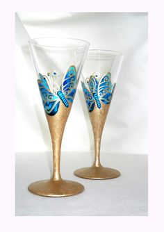 Crystal stemware designed with two hand painted Blue Butterflies on custom designed and painted finish in a soft marbled gold painted stem and base in an organic hand painted styling. A lovely present
