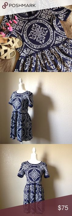 """Romeo & Juliet Fit And Flare Sweater Dress Super cute Romeo & Juliet couture dress in navy blue and white, features fit and flare silhouette, short sleeves, stunning all over victorian pattern, stretchy and lightweight sweater material and back zipper. Like new condition, only worn a couple times, size L. Approximately 38"""" bust, 34"""" waist and 33.5"""" full length. I happily entertain reasonable offers 😊🌸 Romeo & Juliet Couture Dresses Mini"""