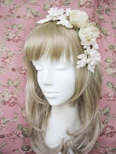VM - Lace rose garland corsage.  Pretty shape of hair accessory
