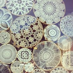 """Window display captured by Anne Sage on Instagram. (Doilies mounted & displayed in embroidry hoops. Tracy says, """"I like this idea as I LOVE to Cro. doilies but then have no where to display them. This solves that problem.)"""