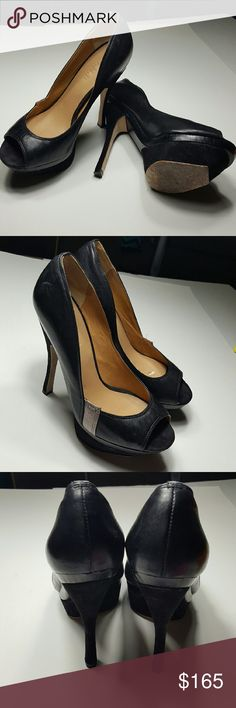 """L.A.M.B Black with Silver Shoe These are absolutely gorgeous!  Priced to sell.  Barley worn comfortable 4.5"""" heel.  The size is not marked, however they fit me and I am a 6.5 shoe.  I can measure them for you with a tape measure upon request for a serious buyer. L.A.M.B. Shoes Platforms"""