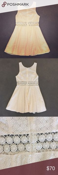 Free People ivory crochet dress Free People ivory crochet dress size 6. This gem is something every woman should have in her closet! Dress up this versatile dress with heels or wear it casually with a pair of sandals. It is not see through as there is a second layer underneath. No tags but it is brand new and has never been worn. In excellent condition! Free People Dresses Mini