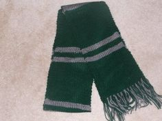Hand knit Slytherin School Colors scarf from Harry Potter. Measures over 65 inches long not including the fringe. 6 inches wide.    Made