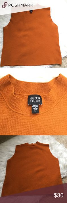 Eileen Fisher Sleeveless Sweater 100% wool. Tried on once but never worn out. Looks great over long sleeve tees! Not an obnoxious orange but more of a burnt earthy tone. Eileen Fisher Sweaters Cowl & Turtlenecks