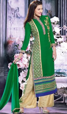 Green faux georgette palazzo suit worn by Gauhar khan displays zari embroidered foliage pattern along the neckline and on one side of the upper half. Cut work and zari embroidered foliage pattern patch placed on other half of the kameez gives a voguish look to the suit. Gota lace and contrast color striped hemline frames the look of the suit.  #FabGreenPalazzoSuit