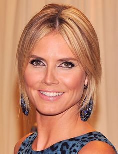 Putting your hair up, but don't want a harsh look? Keep a few strands in front, like Heidi Klum, to soften the style and frame the face.