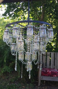 This chandelier is made from a wagon wheel and mason jars. wagon wheel with 16 mason jars. It measures 4 from top to bottom. This chandelier is hard wired with plug Mason Jar Chandelier, Outdoor Chandelier, Outdoor Lighting, Outdoor Decor, Chandeliers, Wheel Chandelier, Lighting Ideas, Chandelier Ideas, Exterior Lighting