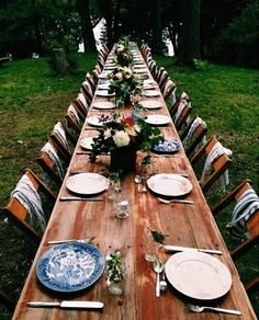 Rustic table settings for a summer camp wedding