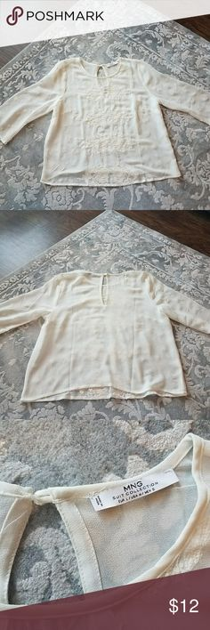 Ming Embroidered Top Delicate and gorgeous flower embroidered top, key hole in back, 3/4 sleeve. Priced to sell. Ming Wang Tops Blouses
