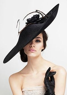 Glamourous fascinator / hat - love the sheer angle combined with the side swept bun