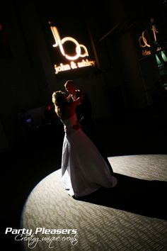 Couple shares first dance with intelligent light and custom monogram  Photo Credit- Ron Shuller Creative Images  #CincinnatiWedding #PartyPleasers #Custommonogram #Intelligentlight Paul Brown Stadium, First Dance, Photo Credit, Darth Vader, Monogram, Couples, Concert, Creative, Party