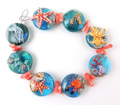 Make these in poly clay and embed in resin. Shown are lampwork glass. Corinabeads -Lampwork beads by Corina Tettinger