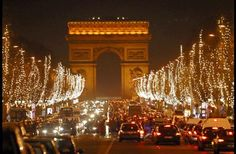 Walk the lighted Champs-Elysées, one of the most beautiful streets in the world.
