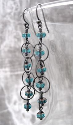 Long dangle earrings with teal aqua faceted glass beads wire-wrapped onto oxidized sterling silver circle link chain.