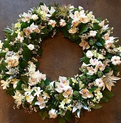 awesome vancouver florist Katherine designed such a beautiful memorial wreath. Love the cotton and orchids. #flowerfactory #wreaths by @flowerfactory  #vancouverflorist #vancouverflorist #vancouverwedding #vancouverweddingdosanddonts