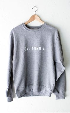 "- Description Details: Chill in our soft & cozy oversized sweater in grey with print featuring 'California'. Brand: NYCT Clothing. Unisex, oversized/loose fit. Measurements: (Size Guide) XS/S: 40"" bus"