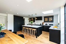 We recently fitted this beautiful bespoke kitchen for a lovely couple in Kent. The dark cabintery is hand painted in Mylands 'Sinner' and finished with brass handles and hinges. This kitchen is in our Westminster range - a classic framed shaker style. Kitchen Room Design, Modern Kitchen Design, Dining Room Design, Kitchen Layout, Home Decor Kitchen, Kitchen Interior, Home Kitchens, Dark Kitchens, Kitchen Ideas