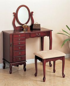 """Winlock 36"""" Vanity Set with Stool in Cherry by Coaster Home Furnishings. $290.65. Some assembly may be required. Please see product details.. 300073 Features: -Vanity set with stool. -Cherry finish. -Storage drawers. -Oval mirror. -Matching stool. Specifications: -Stool dimensions: 17.5'' H x 16'' W x 14'' D. -Vanity dimensions: 48.25'' H x 36'' W x 16'' D.. Save 86% Off!"""