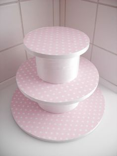 Here is a simple DIY cupcake stand.  Finish off with coordinating party colors or theme paper and ribbon.