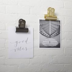 Shop photo clips. A modern new way to display photos, mementos or display unframed prints. Hang on a nail or hook from the hole in the back.