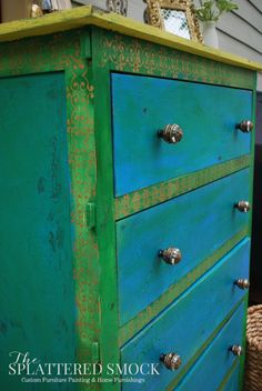 Bohemian Dresser painted with 4 paints:  Base: MMS Curio, General Finishes Corinth Blue and Emerald, Top with Annie Sloan English Yellow.