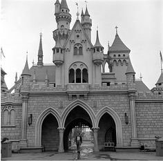 Walt walking through Sleeping Beauty Castle in Disneyland.