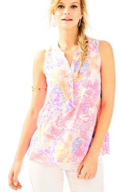 0c89d41dcc79c The Kery Silk Top is a printed silk sleeveless blouse with a flouncy flair  that is