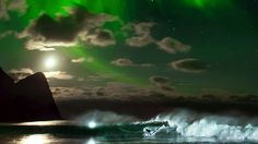 Mick Fanning surfs under the Northern Lights in Lofoten, Norway. Photo: Courtesy of Emil Sollie & Mats Grimsæth/Red Bull