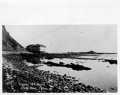"Looking south at the White's Point Hot Springs (also known as ""White Point"") hotel (near) and restaurant  (behind.) The rocky shoreline is visible in foreground. Located along  the shore about three miles southeast of Portuguese Bend on property  owned by Rámon Sepúlveda, the resort was built and operated by the  Tagami family and was a popular coastal attraction during the 1920s  and 1930s."