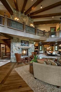 Love the sunburst appearance of the beams, and the stairs hidden behind the fireplace.