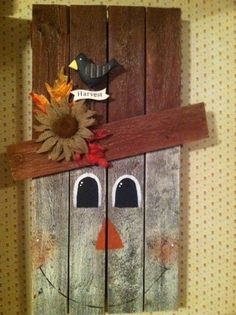 Nail another cross board for the hat and paint a snowman on the other side, wooden snowman www.loveitsomuch.com