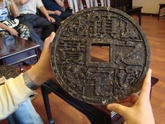 A decorative brick tea, in the shape of old Chinese coin.
