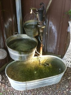 Galvanized fountain - something like this for beside the tool shed.  The wild animals would probably LOVE it.