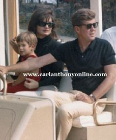 The President and Mrs. Kennedy with son John at the family's weekend home, 1963.