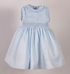 Beautiful blue dress smocked from shoulder to waist. Full view.