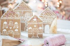 gingerbread house paper bag gift wrap idea.  Super sweet idea...EASY!  Good tutorial included.  craftberrybush.com