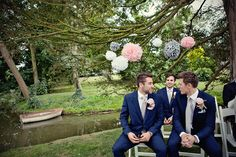 pom poms a go go! Love the groomsmen's suits at this wedding too - photo by Marianne Taylor Photography