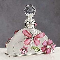 StealStreet Pink Butterfly Perfume Bottle Scented Fragrance Container This gorgeous Pink Butterfly Perfume Bottle Scented Fragrance Container Decoration has got the finest details and most suitable you will find anywhere. The Pink Butterfly Perfume Bottle Scented Fragrance Container Decoration is actually remarkable. Strategy is crafted with: Glass, Steel. ITEM SKU: SS-A-51630. ($14.90)