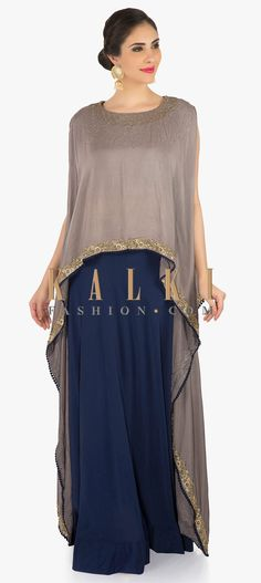 Buy Online from the link below. We ship worldwide (Free Shipping over US$100)  Click Anywhere to Tag Navy Blue dress in satin chiffon embellilshed in zari and thread work only on Kalki This navy blue dress in satin chiffon is nothing but just fabulous. Deck up in this navy blue dress with attached cape in grey which is adorn in scattered sequin work. Beneath the navy blue dress is crafted in zari and thread embroidery work.