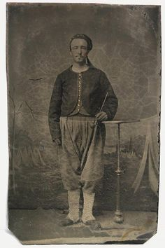 "Civil War CDV sized plate 3 7/8"" X 2 7/16"" tintype of an Zouave Soldier holding on to a long smoking or tobacco pipe."
