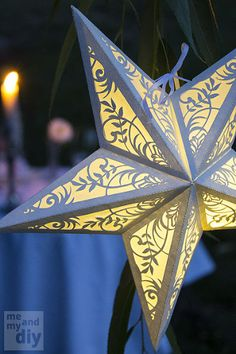 create some ambiance with diy paper star lanterns, crafts, electrical lighting, outdoor living, Adding floral cutouts to the basic design and lining the sides with tracing paper makes a stunning lantern perfect for a summer wedding Paper Star Lanterns, Paper Lantern Lights, Paper Star Lights, Lantern Craft, Paper Light, Kirigami, Christmas Crafts, Christmas Decorations, Christmas Ornaments