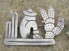 http://www.ebay.com/itm/VINTAGE-MEXICAN-TAXCO-SLEEPING-WITH-CACTUS-STERLING-SILVER-PIN-/370641778141?pt=LH_DefaultDomain_0=item564bf8b5dd