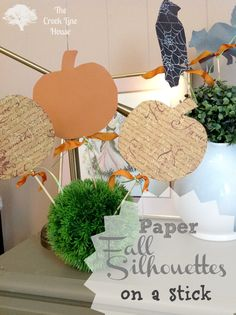 The Creek Line House: Paper Fall Silhouettes on a Stick-this is a good fine motor practice for the kids too-trace the shapes and let them cut them out!