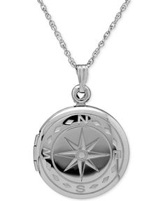 Give your look direction with this compass locket necklace in sterling silver. Approximate length: 18 inches. Approximate diameter: 1 inch. | Photo may have been enlarged and/or enhanced. | This item