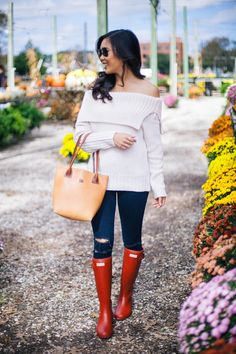 Off the shoulder sweater with a handmade leather bag