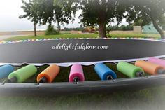 Pool noodles to cover coils on trampoline - genius!
