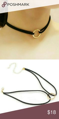 Faux Leather Round Geometric Choker Faux black leather open design with gold tone round geometric design. Choker necklace Jewelry Necklaces