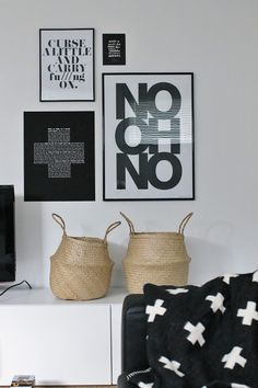 Natural fiber baskets. Typography gallery wall. Black and White Swiss Cross Blanket.