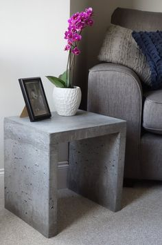 A handmade, concrete side table. Each table has its own unique surface detail. We believe in the rough beauty of concrete and are not interested in working against its natural materiality. Therefore our products celebrate the natural Table Beton, Concrete Table, Concrete Furniture, Concrete Design, Home Furniture, Concrete Cement, Polished Concrete, Diy Concrete Mold, Urban Furniture