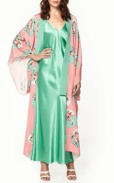 This Racil mameha kimono features an asymmetrical hemline and open sleeves. Product Details Pattern throughout Contrast color around neckline 100% viscose Composition: 100% silk Color: Pink Fan Open Made in United Kingdo